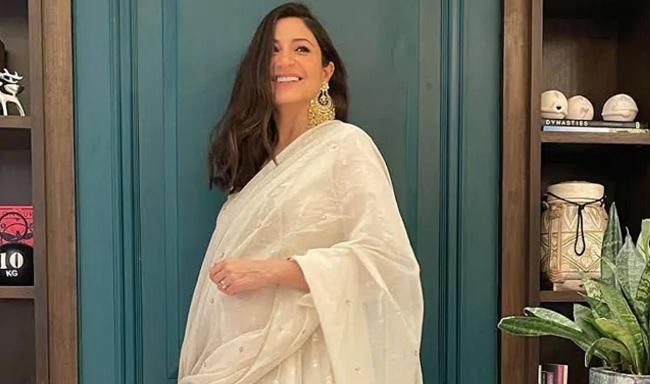 Anushka flaunts pregnancy glow in white ensemble