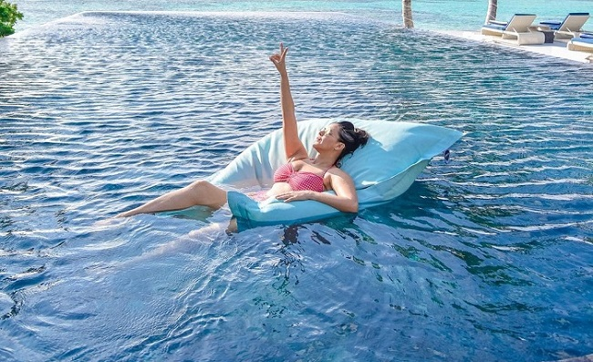 Pics: Kerala Beauty Warms Up In Swimwear