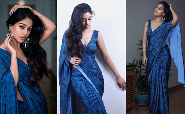 Pics: Beauty Draped In Blue Saree