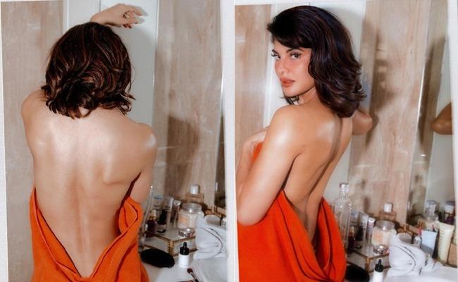 Pic Talk: Jacqueline Flaunts 'sexy back'